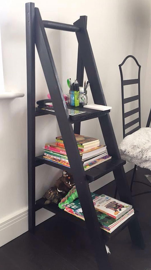 Black ladder shelves with vertical space saving back and large platforms for storage and display purposes