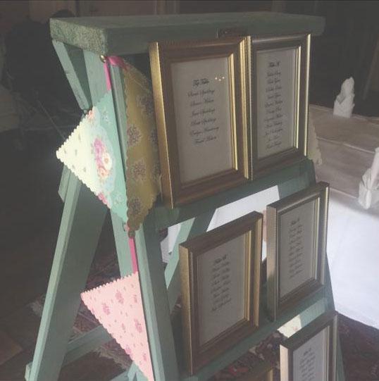 wedding seating arrangement display   timber step ladders